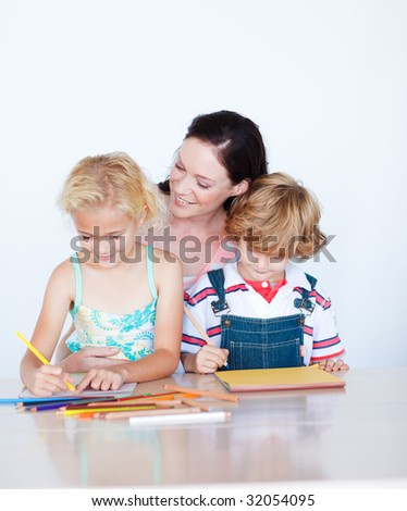 Mother painting with her children at home - stock photo