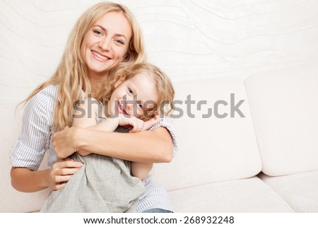 Mother playing with baby at home - stock photo