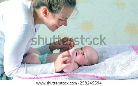 mother playing with baby boy - stock photo