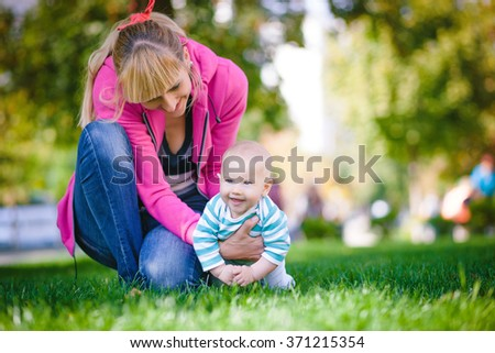 Mother playing with baby in nature