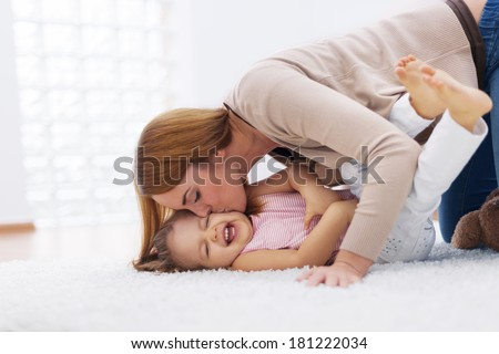 Mother playing with her baby  - stock photo