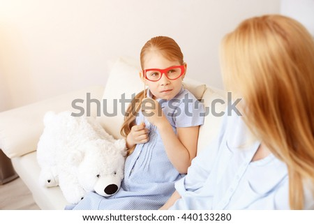 Mother playing with her daughter at home - stock photo