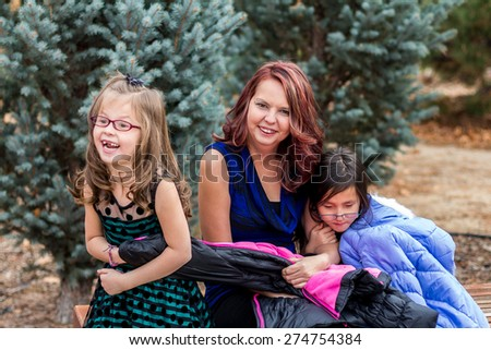 Mother playing with her daughters at a park in Reno, Nevada, USA.  - stock photo