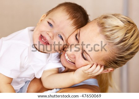 mother playing with her son; closeup faces