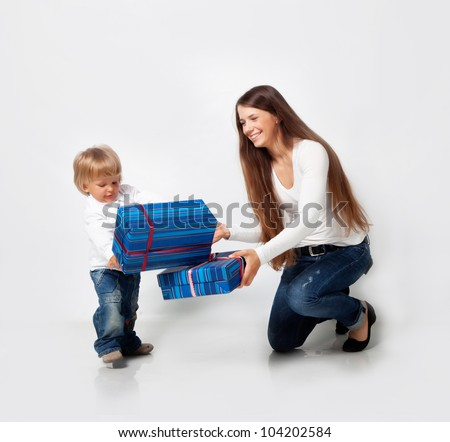 Mother playing with son in studio - stock photo