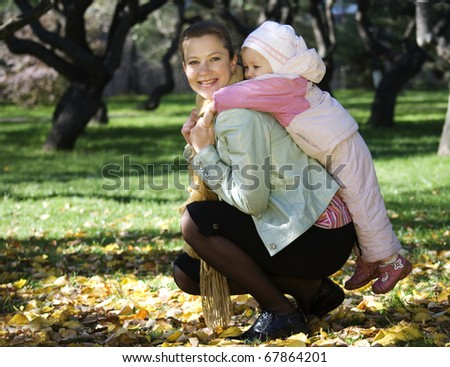 Mother plays with the daughter - stock photo