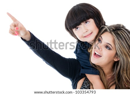 Mother pointing something to her son - isolated over a white background