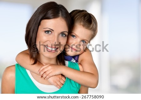 Mother. Portrait of a daughter embracing her mother from behind - stock photo