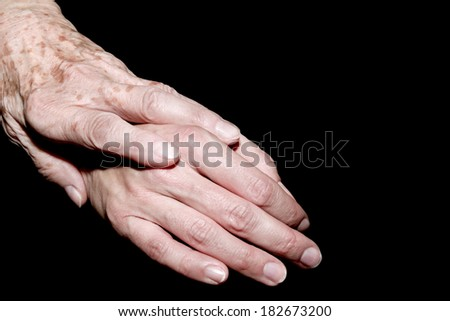 Mother puts her hand on the hand of her daughter - stock photo