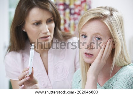Mother Questioning Teenage Daughter About Pregnancy Test - stock photo