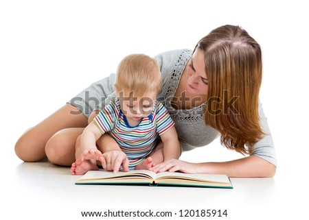 mother reading a book her baby boy - stock photo