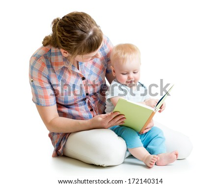 mother reading a book to her baby boy - stock photo