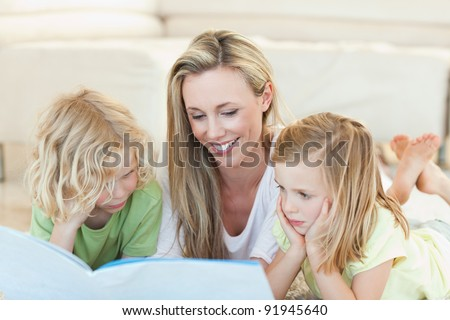 Mother reading story for her children - stock photo