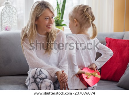 Mother receives present from her child - stock photo