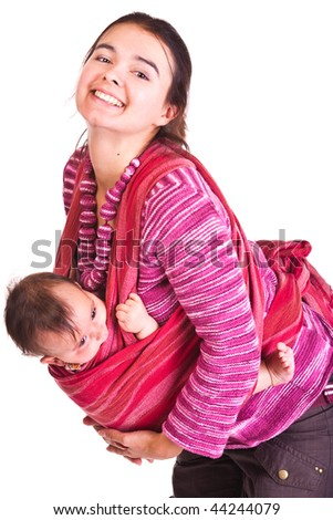 Mother rocks baby to sleep in sling - stock photo