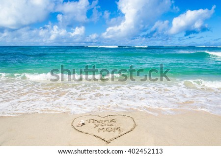 "Mother's day background on the sandy beach near ocean, sign ""Thank you mom"""
