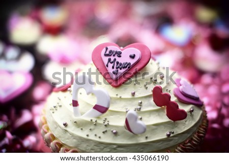 Mother's Day cake with a circle of cupcakes effect vintage .blur and noise photo . - stock photo