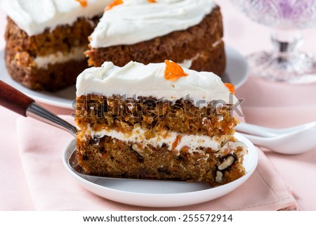 Mother's day carrot cake, homemade moist and sweet layer cake with grated carrot,  walnuts and dried apricot topped with swirls cream cheese frosting.  Delicious delight for holiday