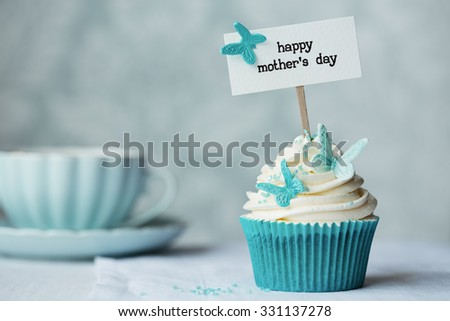 Mother's day cupcake with copy space to side - stock photo