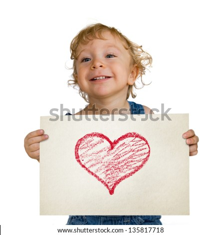 Mother's Day Gift: cute kid holding a drawing with a heart - stock photo