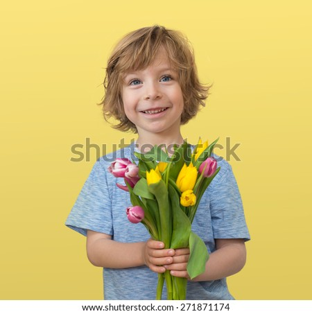 Mother's day greetings: little boy holding a tulips bouquet