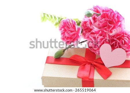Mother's day present and carnation bouquet with message card - stock photo