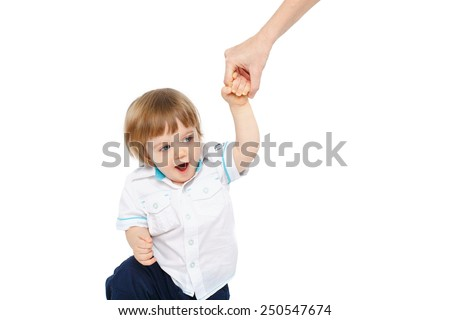 mother's hand holding baby's hand while he walking - stock photo