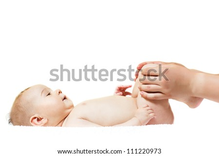 Mother's hand massaging baby feet.