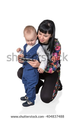 Mother sat down and teaches young son use a smartphone isolated on white background