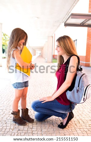 Mother saying goodbye to her daughter at school