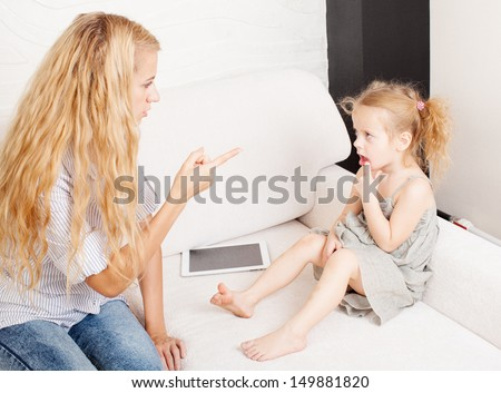 Mother scolding baby. Parent upbringing little child - stock photo