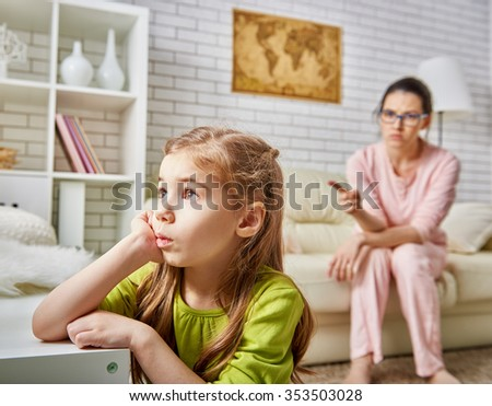 mother scolds her child girl. - stock photo