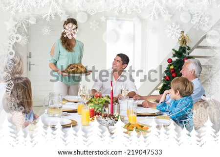 Mother serving Christmas meal to family against fir tree forest and snowflakes