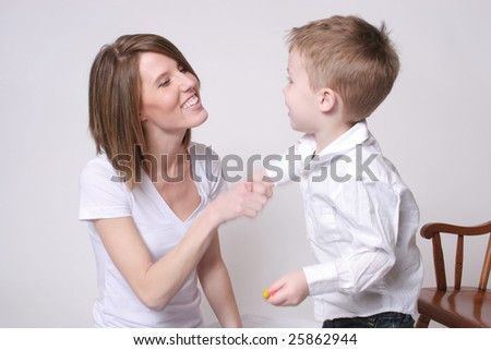 Mother shaking hands with her son