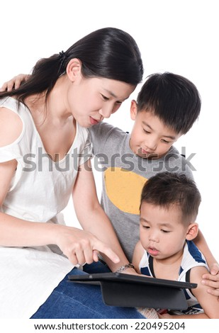 Mother showing her son how to use tablet PC.a sitting long wooden chair