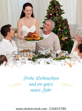 Mother showing turkey to her family for Christmas against border - stock photo
