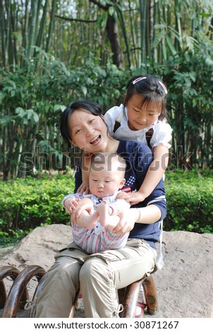 Mother,sister and little baby boy - stock photo