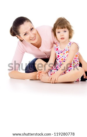 mother sits with little beautiful girl isolated on white background - stock photo