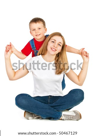 Mother sitting cross-legged and her little son