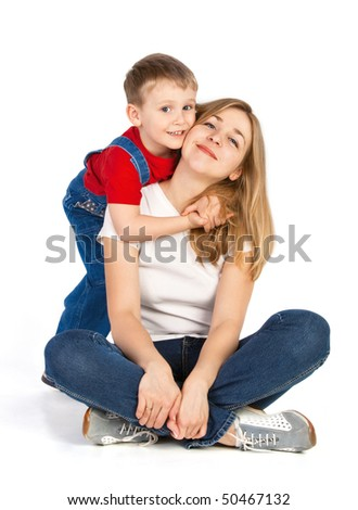 Mother sitting cross-legged and her little son - stock photo
