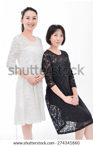 Mother sitting cube and daughter portrait - stock photo