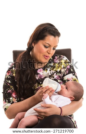 Mother sitting on chair and feeding newborn baby isolated on white background - stock photo