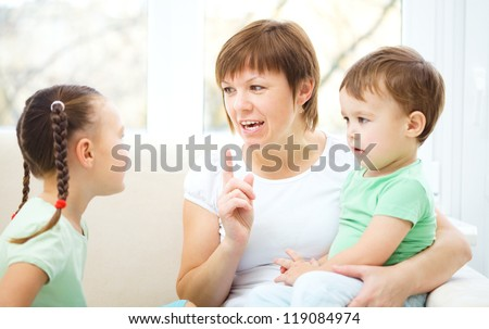 Mother talking to her children, indoor shoot