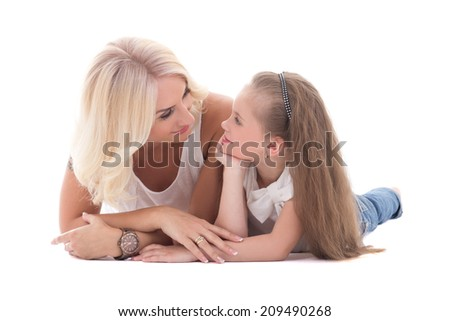 mother talking with her little daughter lying on the floor isolated on white background