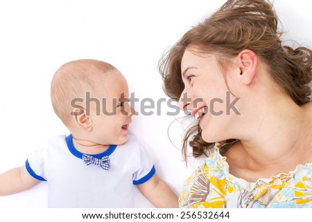 Mother talks with her baby boy on withe background - stock photo