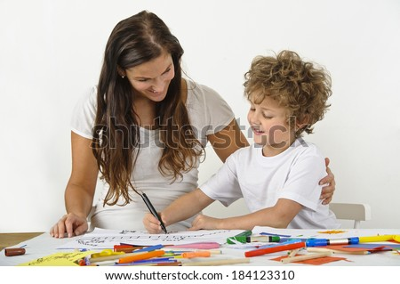 Mother teaches her child how to draw