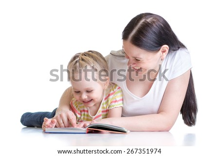 mother teaches reading book to child daughter - stock photo