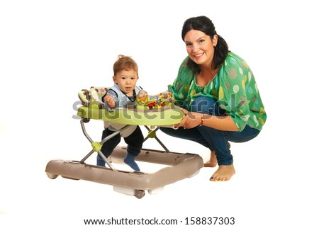 Mother teaching baby in walker in their home