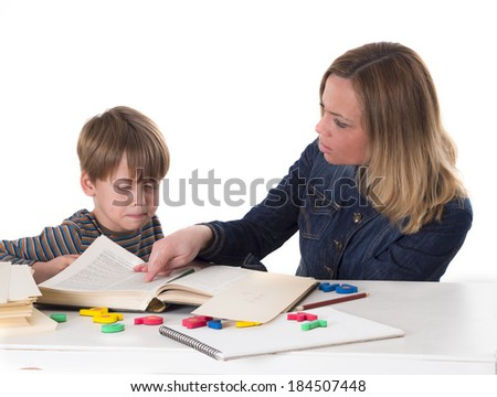 mother teaching her son - stock photo