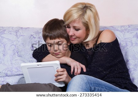 mother teaching her son how to use computer